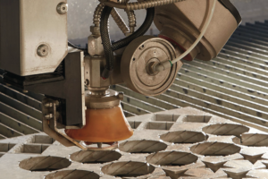 Detail of a waterjet cutting shapes