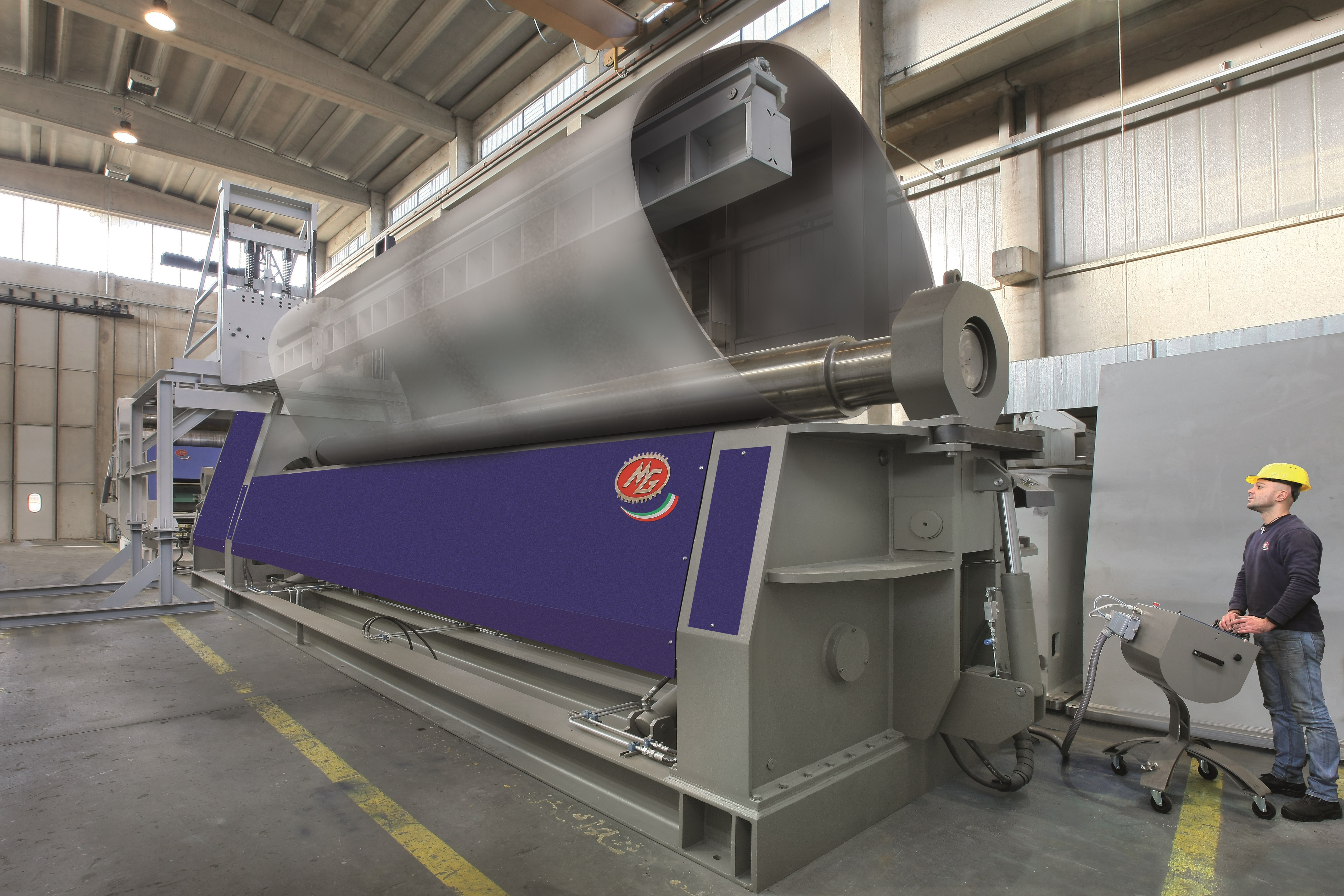 Large oval sheet metal being rolled on a MG CNC Bending Rolls