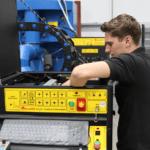 An engineer repairing an Ajan Plasma Cutter