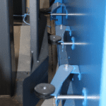 The levers that operate the Zoned Extraction System of the Ajan Plasma Cutting Machine