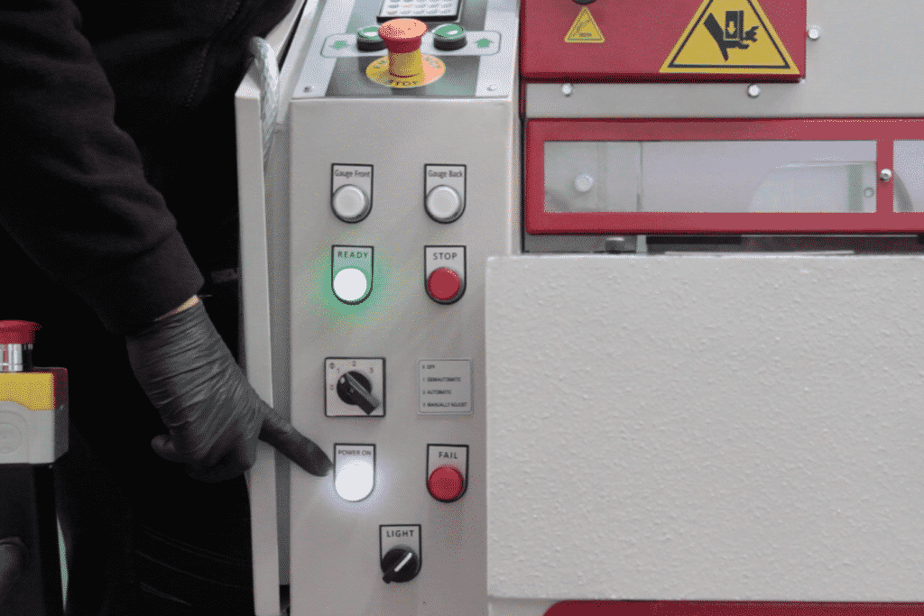 Image of the front of the machine with hand pointing at the controls