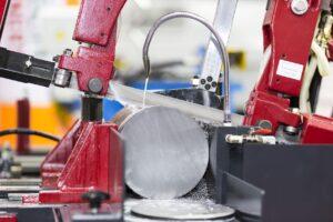 Image of bandsaw blade cutting metal
