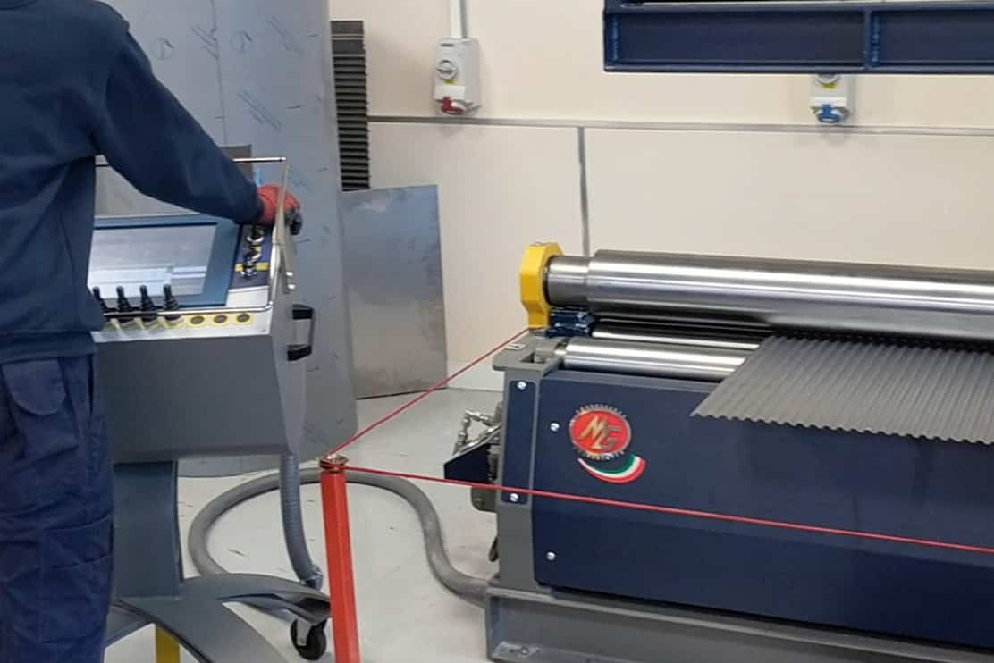 Image of Limpfield working the CNC MG Bending Rolls in their warehouse
