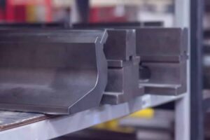 Image of Pressbrake V Tooling on racking waiting to be installed.