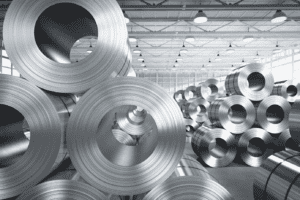 Stacks of metal alloy tube in a warehouse