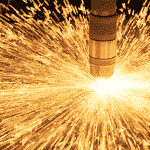 Close up of a hypertherm plasma torch sparking whilst cutting