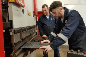Image of apprentice and Pembrokeshire college lecturer using a Morgan Rushworth Press Brake
