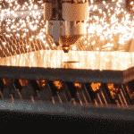Image of Laser Head cutting a sheet metal plate