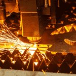 Close up of a Laser head cutting steel