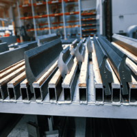 A selection of different press brake toolings displayed on racking