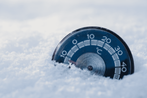 Image of a gauge in snow showing minus figures