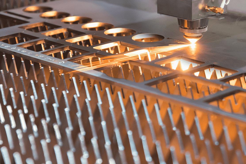 Close up of Raytool Cutting Head cutting sheet metal